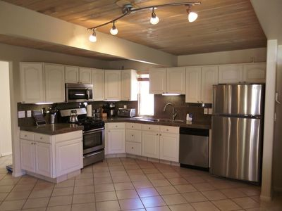 Open kitchen with gas range and stocked for your cooking pleasure.