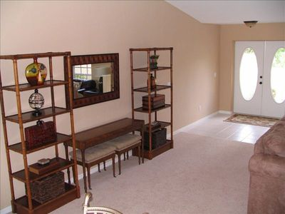 Bright and spacious front entrance with lovely wall unit.