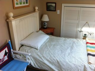 one of three queen size guest bedrooms