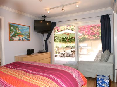 Blue Ocean Bedroom with Queen Bed and HDTV Opens up to the Tropical Yard...