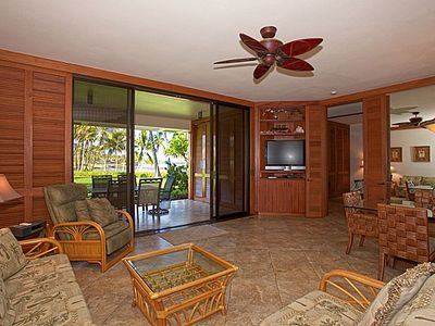 Spacious Living Room with Tile flooring and flatscreen television.