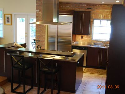 Custom Kitchen with Stainless Counter Tops and Appliances