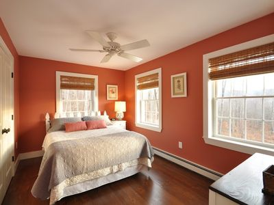 "The ""rose room"" has a playful white picket fence headboard and beautiful views."