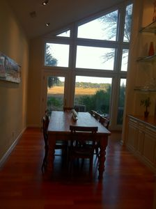 Kitchen Table with Seating for 6-8 Overlooking Patio with Water & Sunset Views