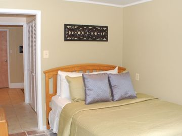 Queen Bedroom. The small hallway leads to a sitting room with Double futon sofa