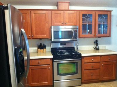 Another kitchen view featuring 'Maytag' stainless steel appliances.