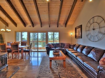 Our open concept living room has lots of room & a deck w/ 'peek' of Lake Tahoe.