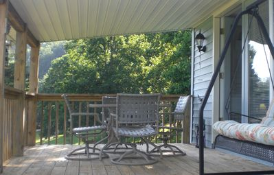 The covered porch is the perfect place to enjoy a picnic and the view, anytime!