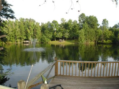 This charming  cozy cottage has a private hot tub, deck for fishing.