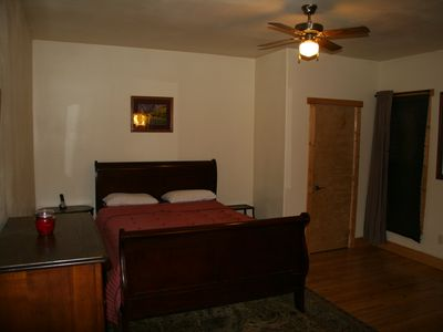 Guffey farmhouse rental - Master suite with king bed and full bath