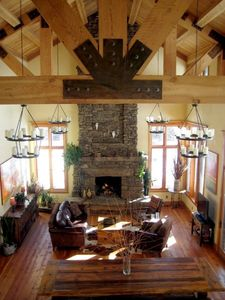 Great Room with 28 foot ceilings, timber trusses and fireplace.