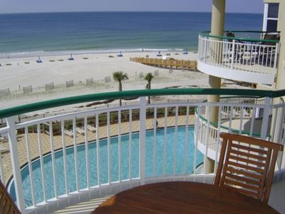 View from this unit's private balcony of gulf and one of the resort pools