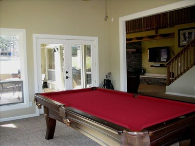 Bonus room w/ Pool Table. White doors lead out to back patio