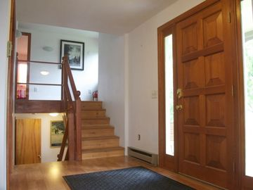 Inside front entrance, steps upstairs and down lead to three bedrooms each.