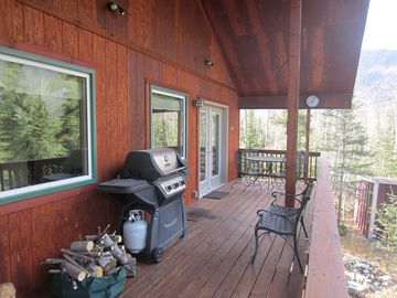 Cooper Landing house rental - The large covered deck is the highlight of the house- enjoy some al fresco time.