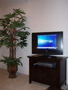 Enjoy your favorite TV shows or movies on our flat-screen TV in the living room