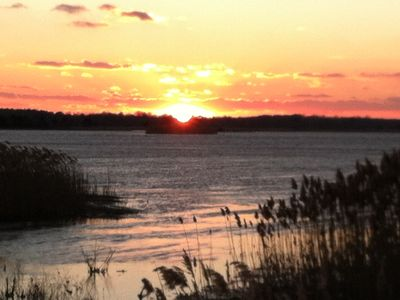 sunset over prime hook wildlife preserve