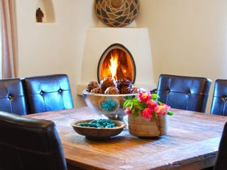 Santa Fe house photo - Recycled teak-wood table.