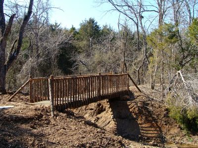 Walking trail bridge approximately 150ft behind Branson Trailside Lodge