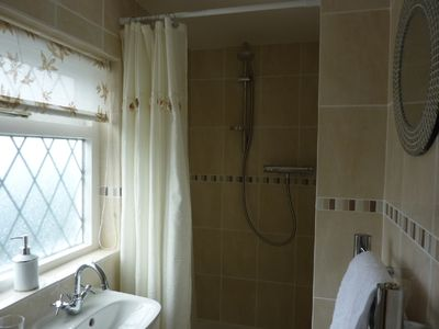 Brand new bathroom with electric shower