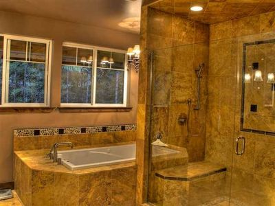 Master suite bath tub and shower.