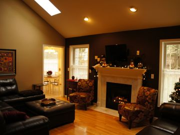 Large living room with seating for everyone around the fire place...
