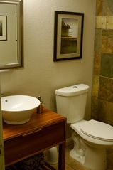 San Antonio bungalow photo - Guest/hall bathroom with vessel bowl sink and custom built cabinet