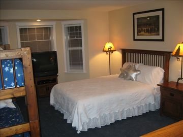 Bedroom with queen bed and bunk bed. Great for a young family or just kids.