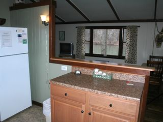 Luray cabin photo - Bar ledge from kitchen to living room