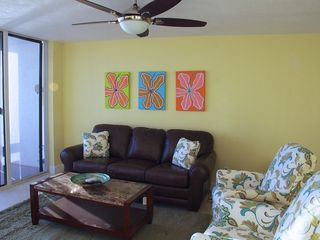 Redington Shores condo photo - Living room with queen air mattress sleeper sofa and recliners.