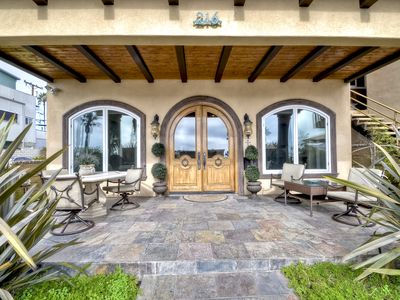 Front entry with shaded outdoor patio seating.Enjoy beach living from here!