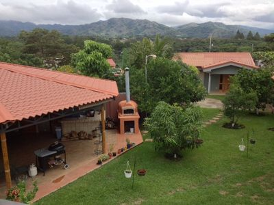 View from the Mirador of the Rancho and Casita. Note the mountains in the background.