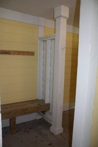 A full bath is located on ground level. Enclosed shower has hot and cold water.