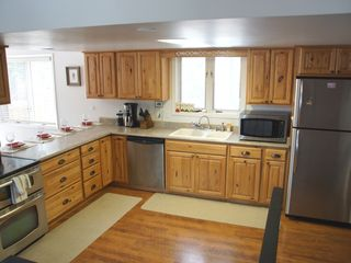 Fraser house photo - Open and spacious kitchen with hickory cabinets and updated stainless appliances