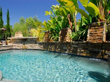 Newport Beach house rental - Private salt-water pool with water fountains adjacent to fireplace, BBQ,fire-pit