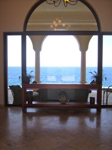 Your view entering the house...overlooking the terrace to the Sea.