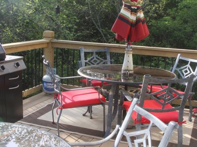 Branson cottage rental - Two Tables on the deck for enjoying morning coffee or evening meals.