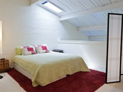 King-sized pillowtop mattress with shuttered skylight.