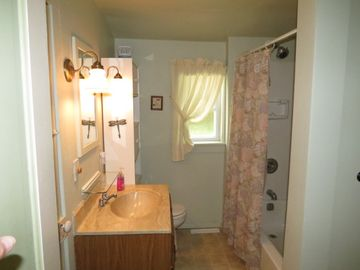 Downstairs Bath, w/ shower & tub. Accessed from the Master Bedroom and Kitchen.