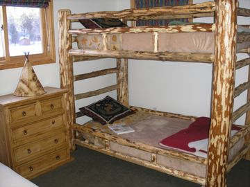 Bunk room with two twins and queen futon.