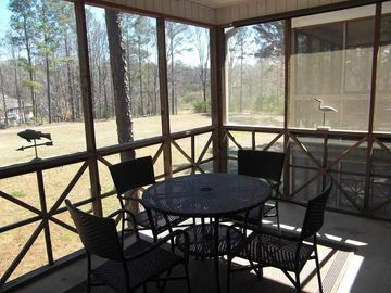 Lake Martin condo rental - Screened Deck overlooking inactive portion of golf course