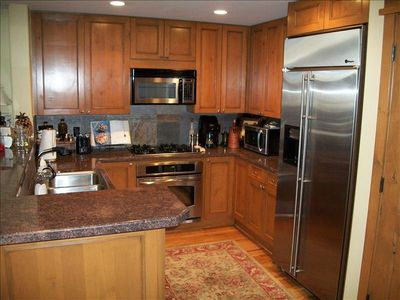 Kitchen with Granite Counters, Stainless Steel Appliances.