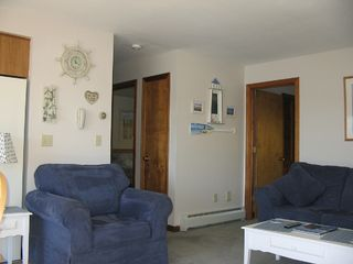 Lake Winnisquam condo photo - Comfy Living Room with Your New Favorite Chair