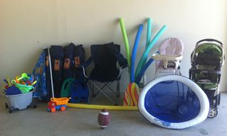Oakland Park house photo - Beach chairs, toys and umbrella along with high chair and stroller