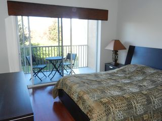 Sun Lake condo photo - Queen bedroom with sliders to the screened patio overlooking conservation area.