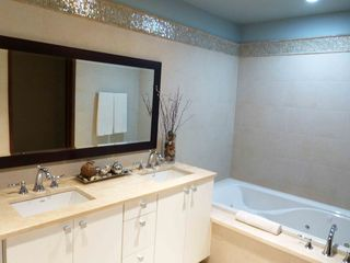 Rio Grande apartment photo - Master bath with his-and-hers sinks, whirlpool tub, contemporary decor.