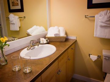 Each room has a private ensuite bathroom with glass walk-in showers.