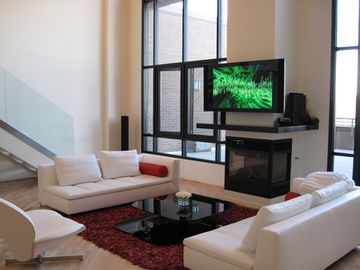 Downtown Scottsdale condo rental - Great Room with gas fireplace & 50' pioneer elite tv
