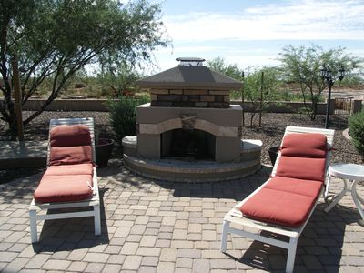 There is an outside gas fireplace and a large gas firepit.