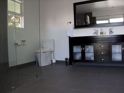 Master en-suite with all modern amenities and views of mountains and pool access